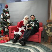 cat and her person with Santa Paws