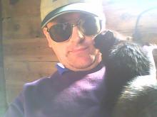 black cat licking human face